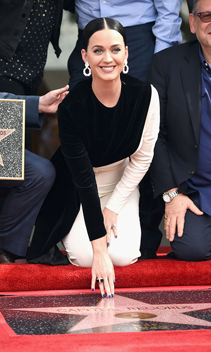 """Roar"" singer Katy Perry was all smiles as she helped her label Capital Records unveil its star on Hollywood's Walk of Fame. The event marked the first time a record label was bestowed the honour. 