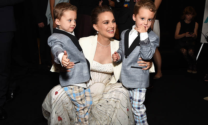 Natalie Portman, who is expecting her second child with husband Benjamin Millepied, hit the red carpet at the premiere of <i>Jackie</i> at this year's AFI Fest with her little co-stars Aiden and Brody Weinberg. The adorable twins play her son John F. Kennedy Jr. in the biopic. 