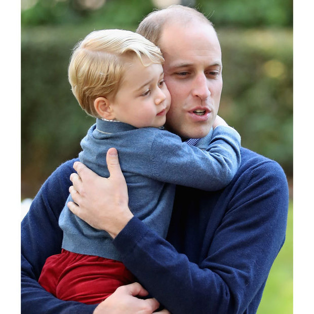 William gave his son a cuddle during the children's party in Victoria. 