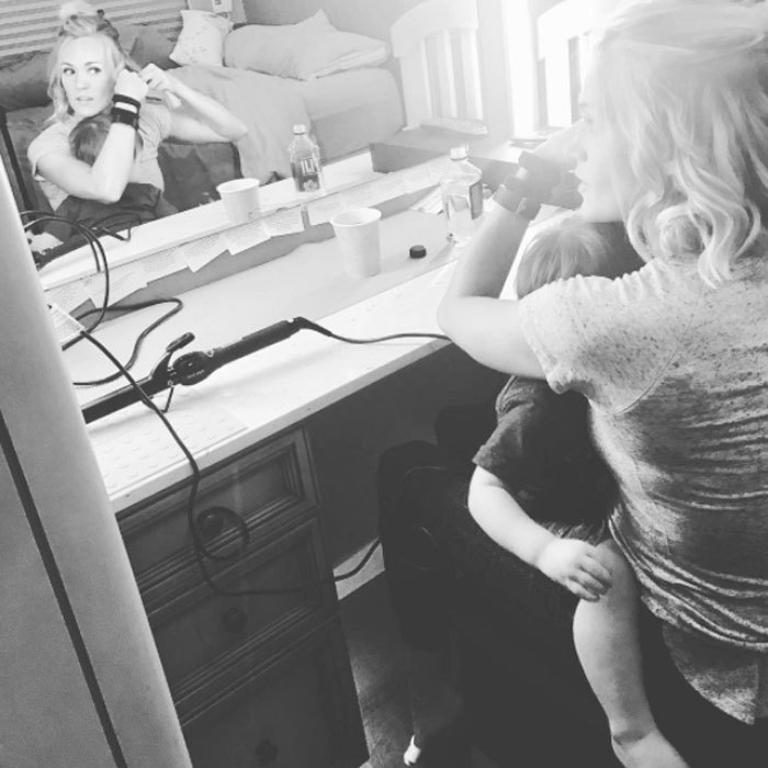 "Getting ready for a show couldn't stop Carrie Underwood from cuddling with her son. The country star shared a photo doing her hair as Isaiah sweetly rested on her lap. Carrie wrote, ""He doesn't care that Mommy had to get ready for a show... all he knows is that he woke up cranky from his nap and needed a cuddle... and I was more than happy to comply. #multitasking #momlife #roadlife #thestorytellertour.""