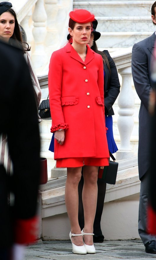 Charlotte Casriaghi looked characteristically chic in a red ruffle-trimmed coat and matching hat with veil.