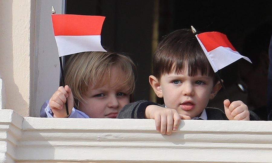 Royal cousins Sacha and Raphaël waved tiny Monaco flags.
