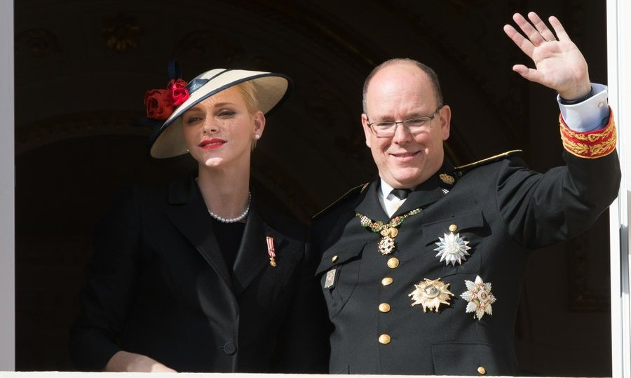 Prince Albert gave a wave with wife Princess Charlene by his side. 