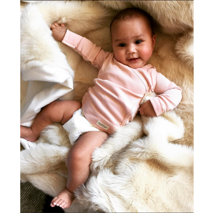 Luna strikes a pose just like her model mom. 