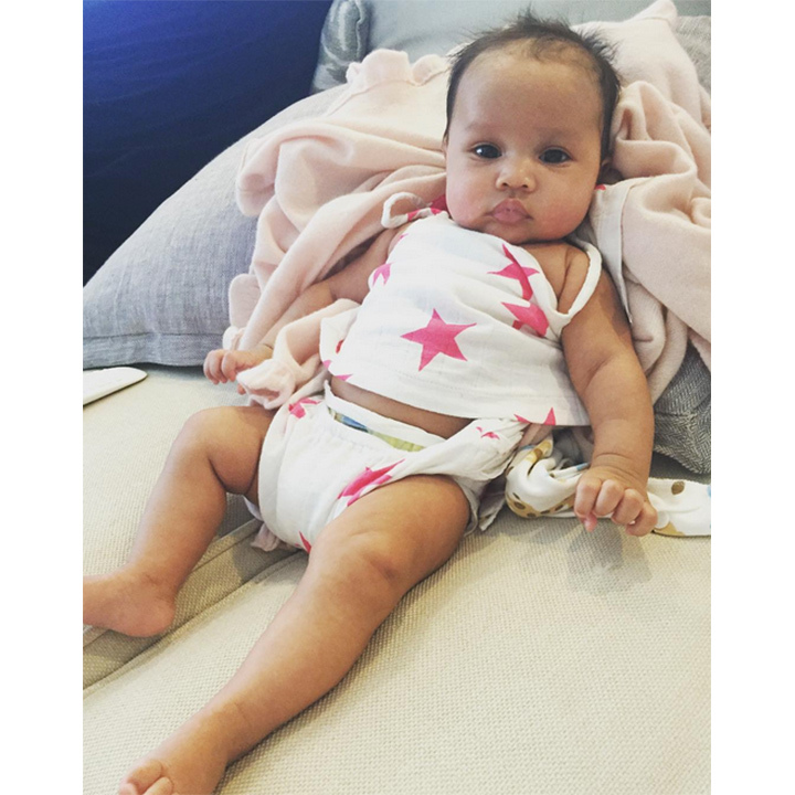 She may only be a couple months old here, but the future superstar is already beach ready. 