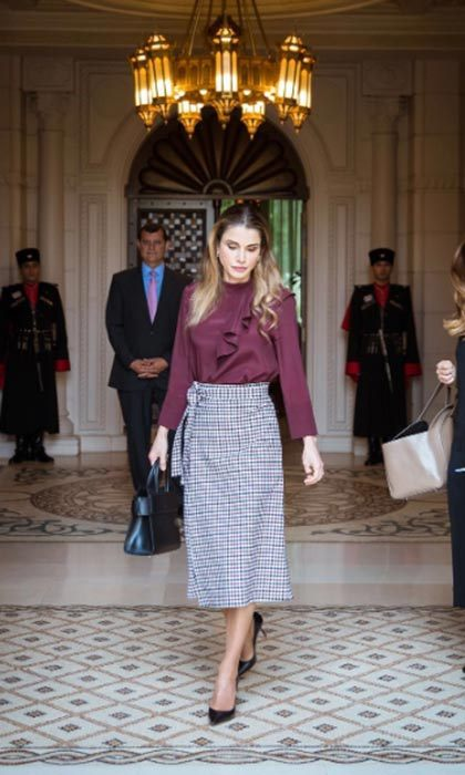 Queen Rania looked stylish in a gingham pencil skirt with a maroon ruched blouse for some meetings at the Royal Hashemite Court.<br>Photo: &copy; Getty Images
