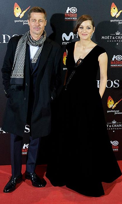 Brad Pitt and Marion Cotillard co-ordinated on the red carpet as they promoted their film <em>Allied</em> in Madrid. While Brad wrapped up in a long tailored coat and jacquard scarf, Marion covered her growing baby bump in a plunging gown.<br>Photo: © Rex