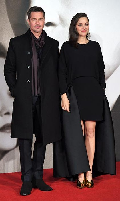The stylish actress turned to Stella McCartney for the London premiere of the film. Meanwhile Brad looked dapper in a black coat and skinny burgundy scarf.<br>Photo: © Rex