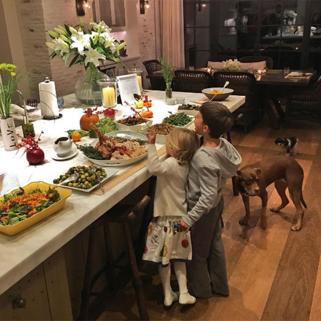 Gisele Bündchen posted an adorable snap of her children taking a sneak peek at the family's delicious-looking feast! 