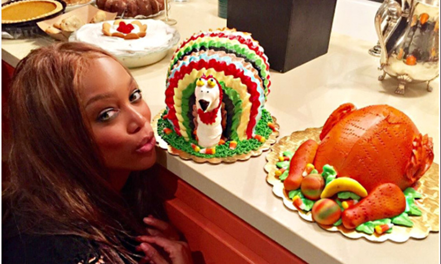 "Tyra Banks revealed her twist on the festivities. ""I was in charge of the turkey. So...I brought 2...turkey cakes. #Thanksgiving"".