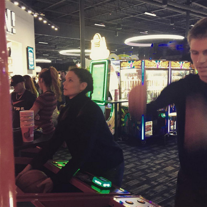 Katie Holmes squared off against her family members at Dave & Buster's back home in Ohio. 