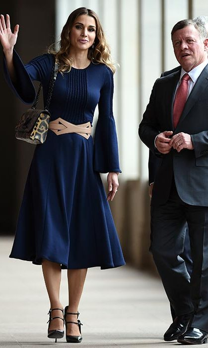 Queen Rania also added a touch of leopard print to her look this week, choosing to accessorise her navy bell sleeve dress with an animal print handbag.