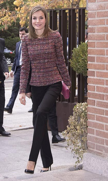 Queen Letizia was stylish and sophisticated in a tweed top and tailored trousers for an engagement in Madrid.