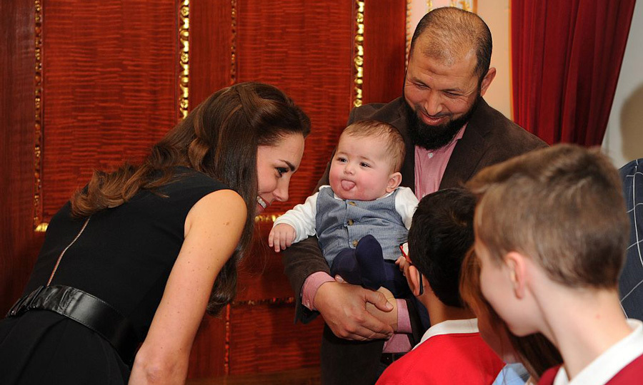 Oops! One baby couldn't help but stick out his tongue as the Duchess of Cambridge greeted children at the 2016 Place2Be Awards in London.