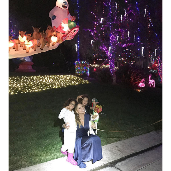 Mariah Carey and her twins Monroe and Moroccan showed off their elaborate outdoor lighting display. 