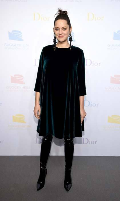 om-to-be Marion Cotillard wore teal velvet Dior to the 2016 Guggenheim International Pre-Party in New York City.<br>Photo: © Getty Images