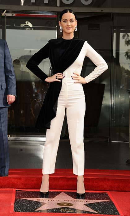 Katy Perry was asymmetrically amazing in this black and white jumpsuit with velvet detailing for the ceremony honoring Capitol Records with a 'Star of Recognition' in Los Angeles.<br>Photo: © Getty Images