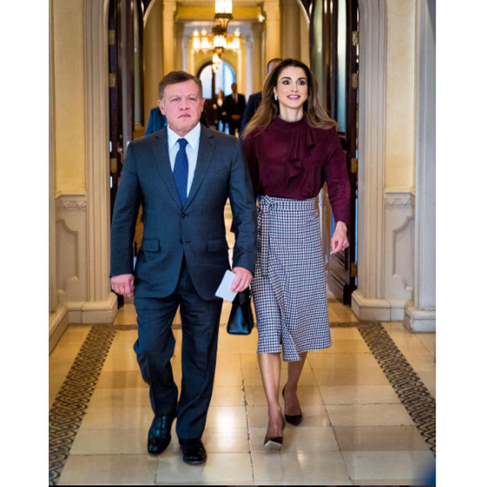 Queen Rania looked effortlessly chic in a high-waist skirt and burgundy blouse as she joined her husband King Abdullah at a meeting on vocational training and human resources development.<br>Photo: &copy; Instagram