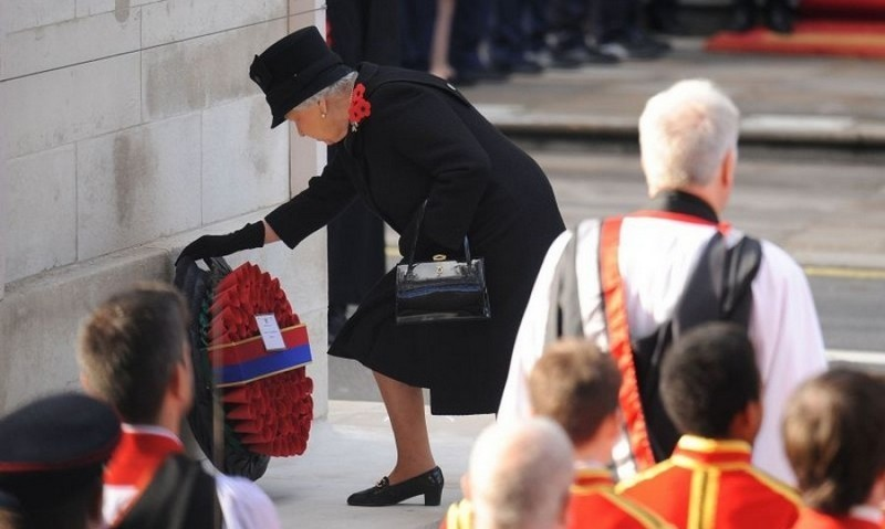 Queen Elizabeth, who placed a lighter wreath than years past, was joined by her family at the Remembrance Sunday Service honoring soldiers who lost their lives in combat.<br>Photo: &copy; PA
