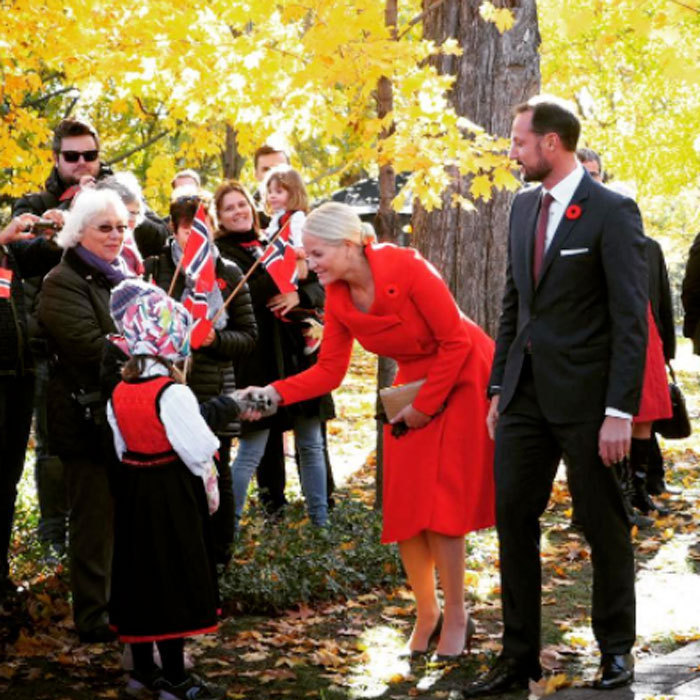 Crown Princess Mette-Marit looked lovely in red as she greeted children from Ottawa during her royal tour of Canada.<br>Photo: &copy; Instagram
