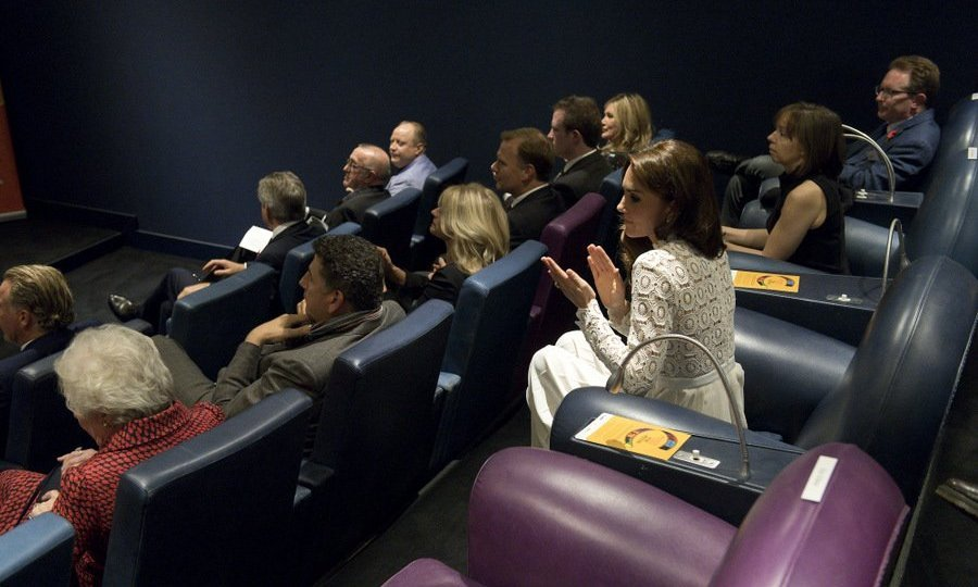 The Duchess of Cambridge, in white, sat third row the cinema room at Working Titles Office in London to watch highlights of the Recovery Street Film Festival.<br>Photo: &copy; Getty Images