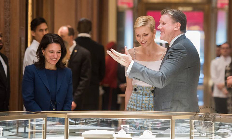Princess Charlene looked elegant in a rose top and high-waisted skirt as she toured the headquarters of the Maison Cartier.<br>Photo: &copy; Prince Palace