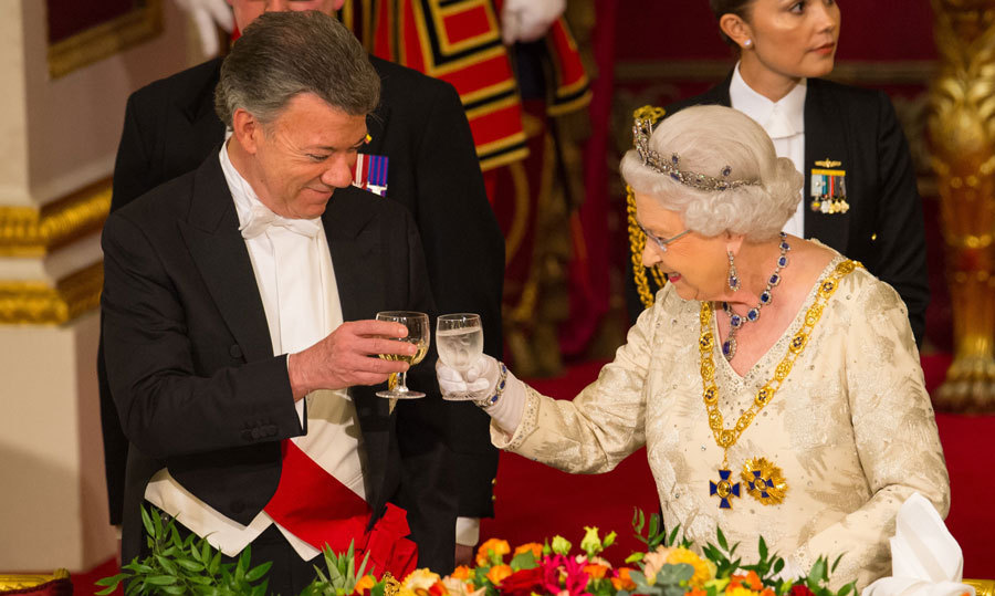 Cheers! Queen Elizabeth welcomed Colombian President Juan Manuel Santos to Buckingham Palace with a State Banquet.<br>Photo: &copy; PA