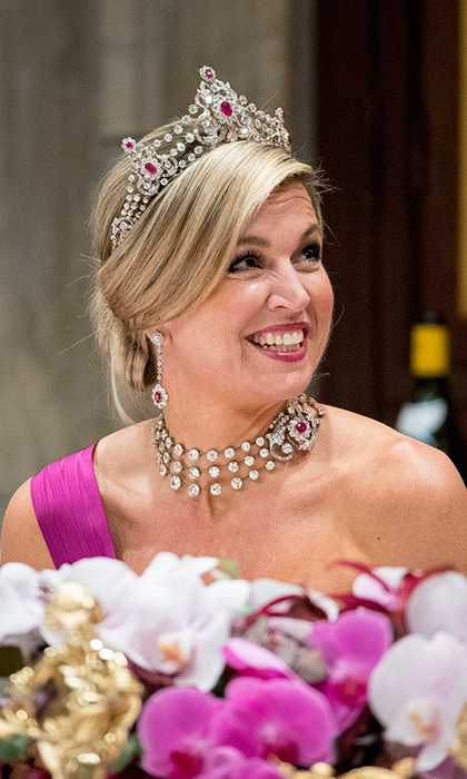 <h2>Queen Máxima of the Netherlands</h2><p>Ruby royalty! The Dutch Queen wore a tiara, earrings, necklace and bracelet from the Mellerio Ruby Parure, a set that has been with the Dutch royal family for over a century. The Queen also wore Queen Juliana's diamond watch.<br>Photo: &copy; PA</p>