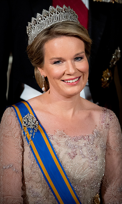 <h2>Queen Mathilde of Belgium</h2><p>The elegant royal wore this crowning glory &mdash; the spectacular Nine Provinces tiara. Mathilde also wore jewels that once belonged to the late Queen Fabiola: her diamond and pearl earrings as well as her diamond waterfall brooch.<br>Photo: &copy; PA</p>