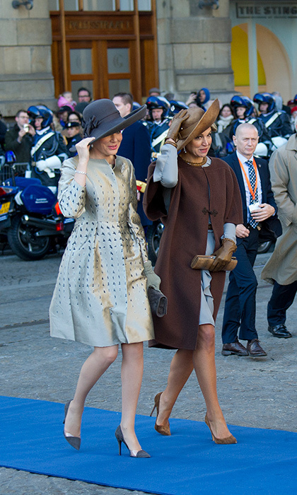 Twinning royals! Not only were Mathilde and Máxima sporting similar ensembles at the Belgian royals' welcoming ceremony, but also similar mannerisms.