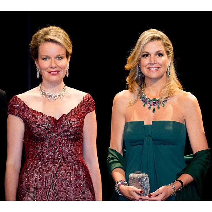 The Queens (Mathilde, left, and Máxima, right) looked regal in gowns and dazzling jewels at a concert held at the concert hall, Muziekgebouw Aan't IJ.