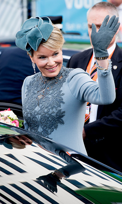 Queen Mathilde looked anything but blue stepping out in a chic ensemble, with matching accessories at Utrecht Central Station in the Netherlands.
