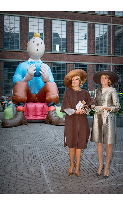 Máxima and Mathilde showed off their similar taste in fashion wearing three-quarter sleeve coats and similar styled hats to a photo projection and theater in Brakke Grond.