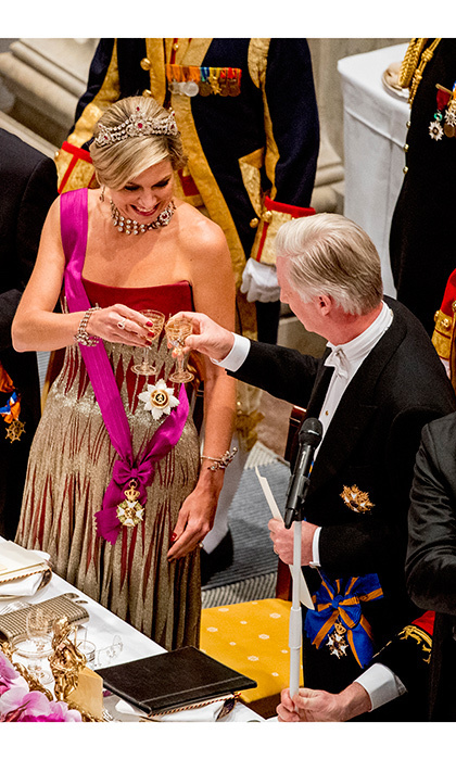 Cheers! King Philippe and Queen Máxima raised their glasses to each other at a state banquet held at the royal palace in Amsterdam.