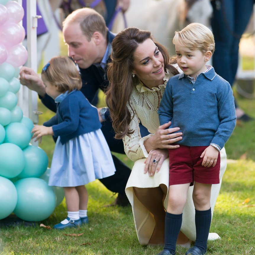September 2016: Prince William kept an eye on balloon-loving Charlotte as Duchess Kate guided little George during a kids' party for military families in Victoria, Canada.