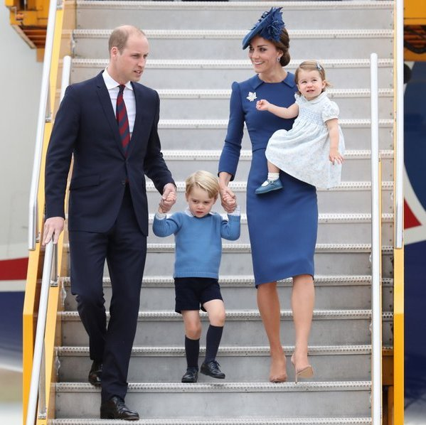 September 2016: Prince William, the Duchess of Cambridge and their children matched in blue as they arrived in for their eight-day tour of Canada.