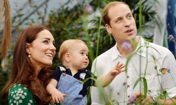 July 2014: Prince William and Duchess Kate explored a butterfly garden with a curious George.