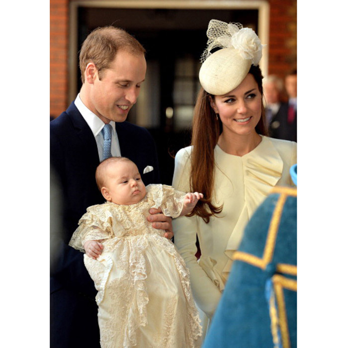 October 2013: Three-month-old George looked pensive during his christening while his father Prince William held him and his mother Kate looked on.