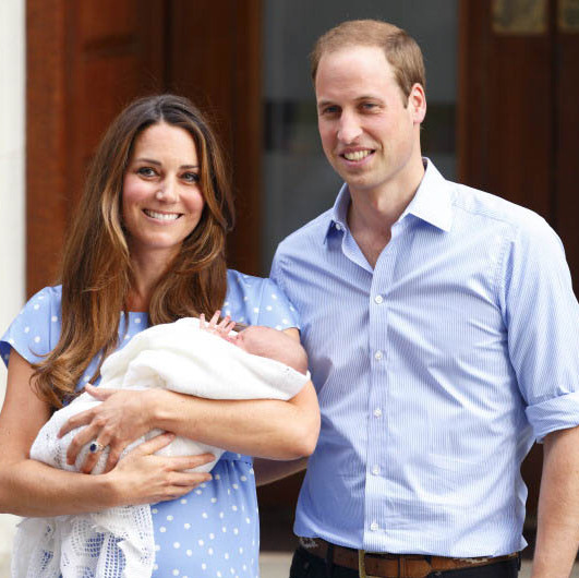July 2013: A royal introduction! Prince William and Kate gave well-wishers a first glimpse of baby George on the way home from the hospital after his birth.