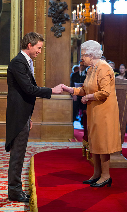 Eddie Redmayne receives OBE from the Queen.