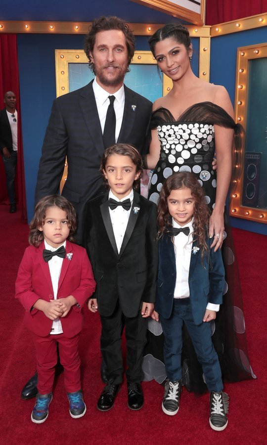 The couple also brought along their three kids — Levi, eight, Vida, six, and three-year-old Livingston, all wearing adorable suits and bow ties.