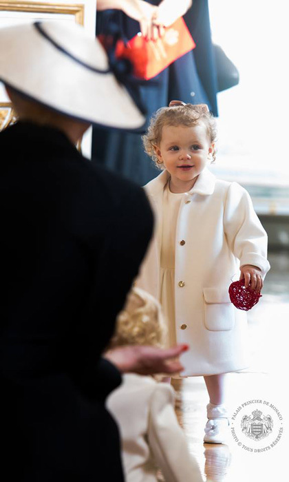 Princess Gabriella looked angelic wearing an off-white Armani Junior dress and matching coat for Monaco's annual National Day celebrations.