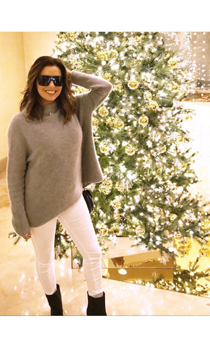 So bright she had to wear shades! Eva Longoria posted this picture of herself and an equally glam Christmas tree.