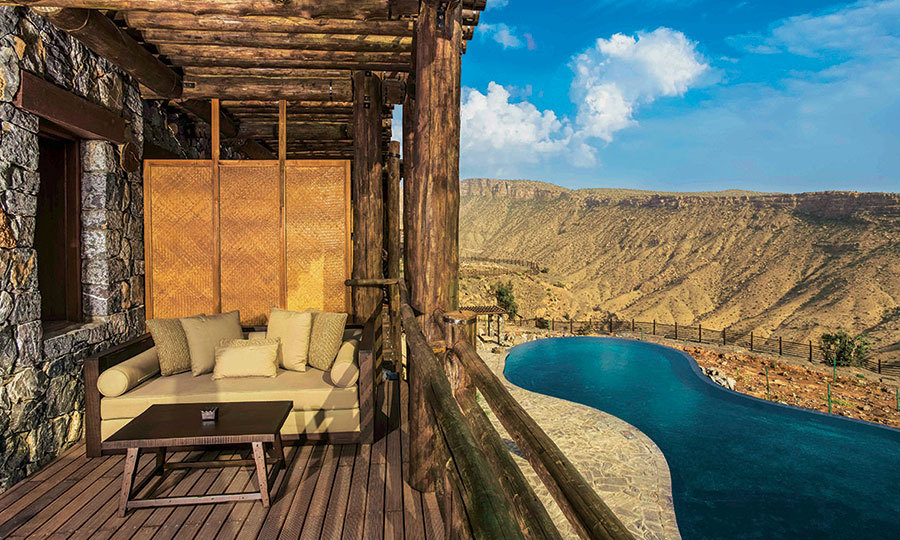 <h2>ALILA JABAL AKHDAR, OMAN</h2><p><strong>Best for ... Total seclusion</strong></p><p><strong>The stay:</strong> High in the Al Hajar Mountains, cradled by rugged limestone outcrops, Alila Jabal Akhdar has been blessed with the sort of stillness that is good for the soul. The rooms mirror the textures and tones of the landscape, with eucalyptus-log balconies and tubs carved from marble.</p><p>Trek along riverbeds dotted with walnut trees and date palms, stop to gawk at the jaw-dropping vistas overlooking the dramatic gorge, then stretch out in the stone cabanas that flank the vast pool. After supper, relax and stargaze on the deck, breathing in the subtle tang of frankincense.</p>
