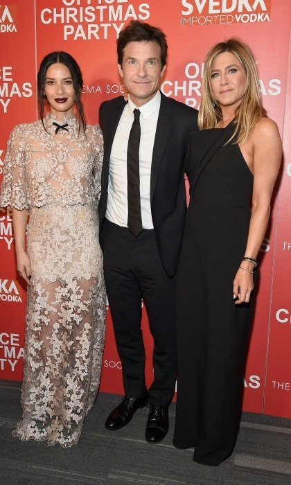 December 5: Olivia Munn stunned in a lace Reem Acra dress next to Office Christmas Party co-stars Jason Bateman and Jennifer Aniston, who wore a chic Brandon Maxwell jumpsuit during the film's Cinema Society screening sponsored by Svedka in NYC.