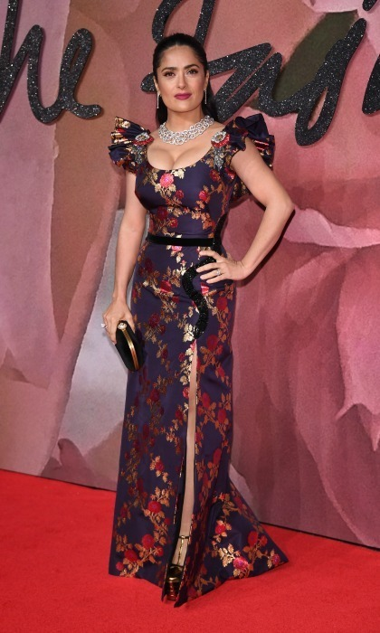 December 5: Salma Hayek worked the red carpet in a printed dress, that showed off her legs, by Gucci during the 2016 British Fashion Awards in London.