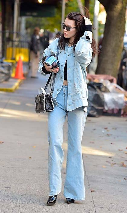 Bella works her own laidback street style, rocking a Canadian tuxedo in true model form.