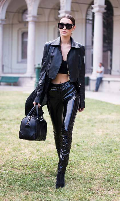 Bella has mastered the off-duty model look in high-shine trousers and a leather jacket.