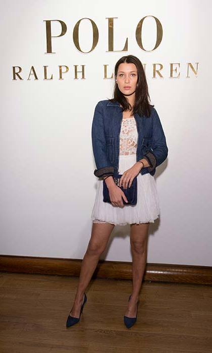 The model threw on a denim jacket over a lace mini dress in February 2015.