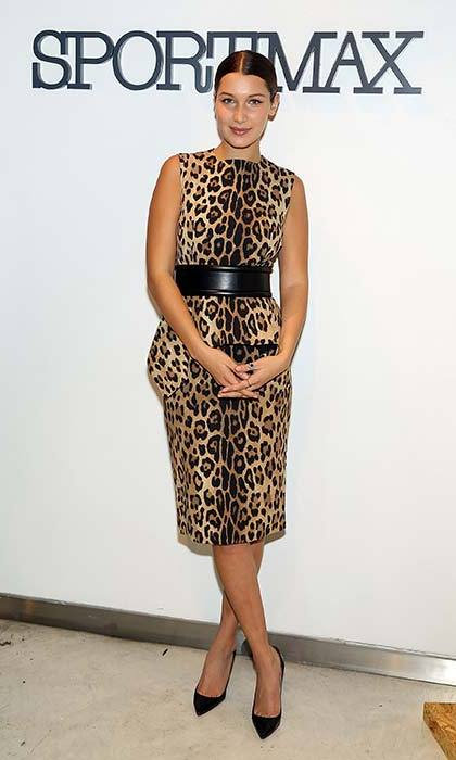 An elegant ensemble, though we're not sure Bella would wear this leopard print midi and pumps now.